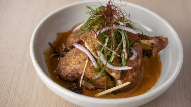 Go-to dish: Crisp-skin corn-fed master-stock chicken with ginger, chilli and satay sauce.