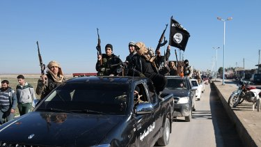 A convoy of Islamic State militants in an image from a post on a militant website last year.