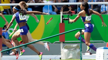 English Gardner and Allyson Felix, right, drop the baton the first time around.