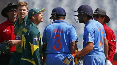 Face to face: David Warner has words with India's Rohit Sharma in Sunday's one-day clash at the MCG.