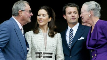 Denmark's Crown Prince Frederik and Princess Mary, centre, talk with Queen Margrethe and Prince Henrik on the balcony of Christian IX Palace in Copenhagen.