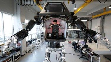 "A human pilot can control the ""Method-2"" robot using arm gestures."