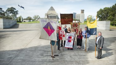 Descendants of WWI soldiers, including Mr Laird, with their banners at the Shrine.