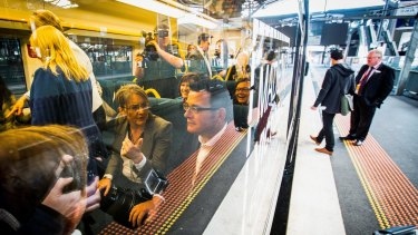 Premier Daniel Andrews and Public Transport Minister Jacinta Allan aboard a V/Line service at a launch for the Regional Rail Link.
