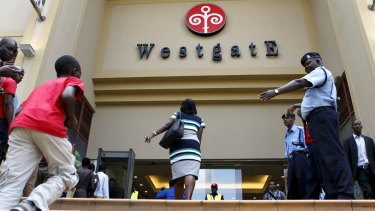 Customers enter the reopened Westgate shopping mall on Saturday.