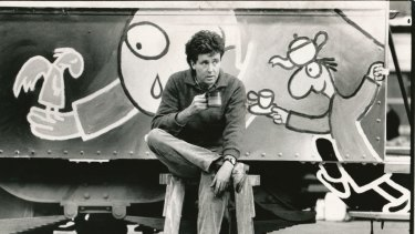Michael Leunig takes a break while painting his art tram in the Preston depot in 1986.