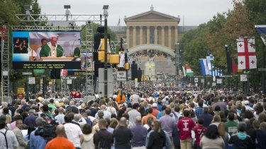 Pope Francis is seen on a huge screen on Benjamin Franklin Parkway in Philadelphia on Sunday.