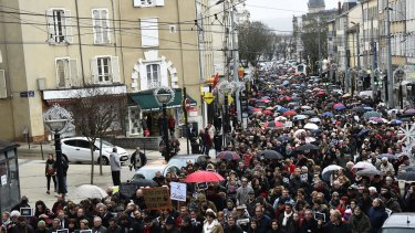 """People hold signs reading """"Je Suis Charlie"""" (I am Charlie) march in Limoges on Saturday."""