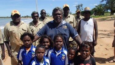 Djambawa Marawili, artist and elder, with local Indigenous rangers and children from the Yilpara Homelands School,Arnhemland.