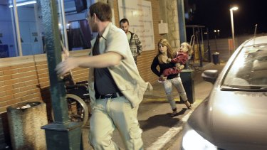Israelis run for cover as a siren wails across the southern city of Ashkelon, on November 10, 2012.