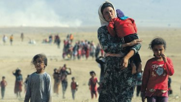 Displaced people from the minority Yazidi sect, fleeing Islamic State militants.