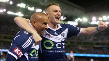 Archie Thompson of the Victory is congratulated by teammate Besart Berisha after scoring Melbourne Victory's third goal.