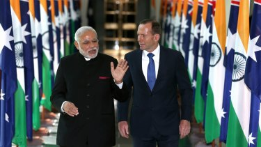 Indian Prime Minister Narendra Modi talks to Prime Minister Tony Abbott during his visit to Australia in November 2014.