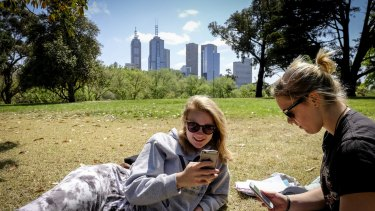 Students Ruby Teather and Michelle Carli spend time at Kings Domain during their lunch break.