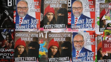 Posters for far right anti-immigration party National Front state in Paris earlier this month.