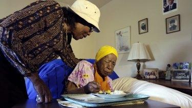 Lois Judge, left, helping her aunt Susannah Mushatt Jones, during breakfast in Jones' room, in Brooklyn, New York last year.
