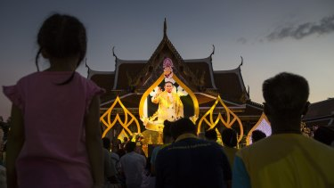Crowds gather to watch a puppet show about his life near the Grand Palace as the celebration for Thailand's King Bhumibol Adulyadej's 88th birthday began earlier this month.