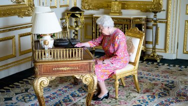 The Queen at her desk in Windsor Castle.