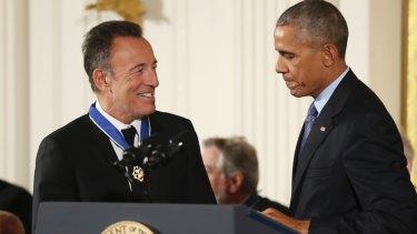 President Barack Obama presents the Presidential Medal of Freedom to Bruce Springsteen in November 2016.