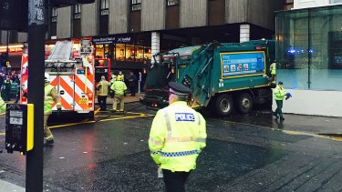 The garbage truck appeared to have run out of control along a pavement in the city centre shopping area.
