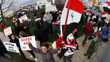 A crowd chants during a rally in opposition to the US air strikes in Allentown, Pennsylvania, one of the US's largest Syrian communities.