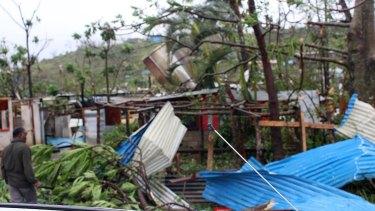Examining the wreckage in Port Vila.