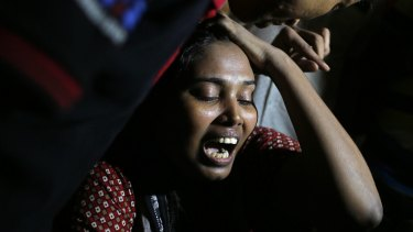 Ashamoni, widow of slain blogger Niloy Chatterjee, whose pen name was Niloy Neel, weeping at her house in Dhaka last year.