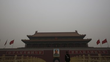 The Tiananmen Gate, where the portrait of China's late Chairman Mao Zedong is displayed is seen on a polluted day, in Beijing in January.