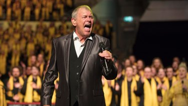 John Farnham performs with at the Queensland Music Festival concert at South Bank Piazza where 2500 singers gathered to sing for change.