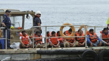 A boat load of asylum seekers arrive on Christmas Island in 2013. Maurice Blackburn is running a class on behalf of detainees.