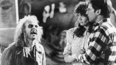 Michael Keaton as the demonic Betelgeuse confronts Geena Davis and Alec Baldwin as Barbara and Adam Maitland in <i>Beetlejuice</i>.
