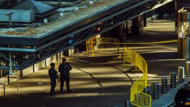 Police stand guard in front of Port Authority Bus Terminal.