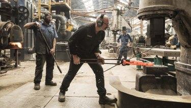 Craftsmen: Anthony Potts watches blacksmith Guido Gouverneur.