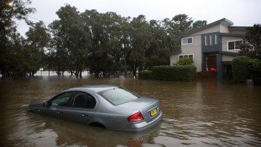 Rising waters inundate Narrabeen Street, Narrabeen.