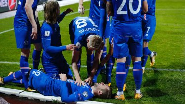 Iceland's players celebrate after scoring against Kosovo.
