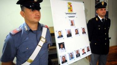 Italian police display mug shots of 11 men suspected of helping Matteo Messina Denaro.