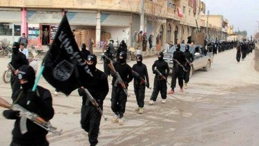 Building coalitions: Fighters from Islamic State march through Raqqa, Syria, in January.