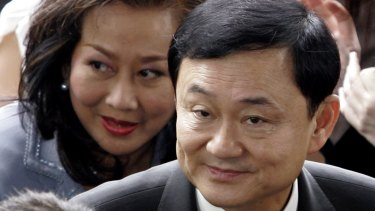 Ousted Thai prime minister Thaksin Shinawatra, front, and his wife Pojaman arrive at criminal court for a verdict in Bangkok in 2008.