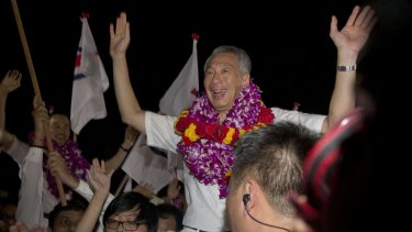 Singapore's Prime Minister Lee Hsien Loong, of the ruling People's Action Party, celebrates his win in Singapore on Saturday.