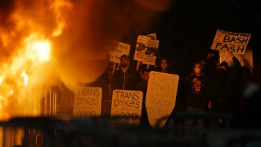 Protestors watch a fire on Sproul Plaza during a rally against Yiannopolous.