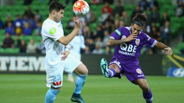 Bruno Fornaroli of Melbourne City is challenged by Jacob Collard of Perth Glory.