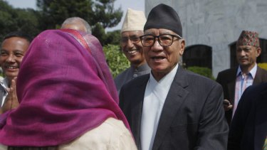 Kul Bahadur Gurung, centre, presidential candidate and leader of Nepali Congress party  arrives to cast his vote for a new president in Kathmandu on Wednesday.