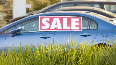 Both of Australia's big listed car dealership firms have downgraded profits in the past 24 hours in a worrying sign for the economy.