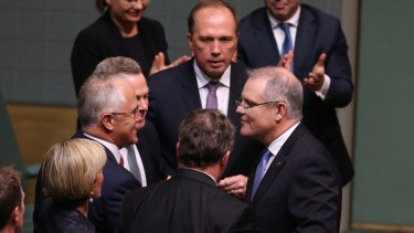 Treasurer Scott Morrison is congratulated by Prime Minister Malcolm Turnbull after he delivered his first budget.