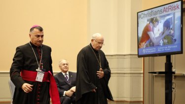 Archbishop Bashar Matti Warda, of Erbil, Iraq, left, and Archbishop Jean-Clement Jeanbart, of Aleppo, Syria, speak at a news conference on Tuesday about the plight of persecuted Middle Eastern Christians.