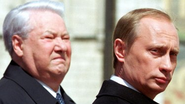 The late Russian president Boris Yeltsin, left, stands with President Vladimir Putin in Moscow in 2000.