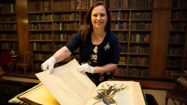 Author Melissa Ashley at Sydney's Mitchell Library with the illustrations by Elizabeth Gould in <i>The Birds of Australia</i> that inspired her novel.
