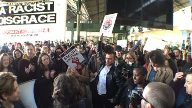 Protesters at Flinders Street Station rally against the Border Force operation in Melbourne on Friday.