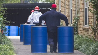 Members of the Protect HazMat team prepare to clear the contents of the apartment of nurse Nina Pham, who is infected with the Ebola virus.