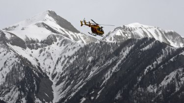 A rescue helicopter from the French Securite Civile flies over the French Alps during a rescue operation after the crash of an Airbus A320, near Seyne-les-Alpes. 144 passengers and 6 crew member died when the Airbus A320 slammed into the French Alps at high-speed.